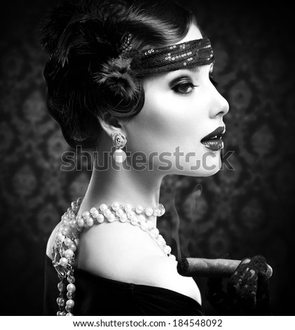 Retro Woman Portrait. Vintage Styled Girl With Cigar. Smoking Lady. Vintage Styled Black and White Photo. Old Fashioned Makeup and Finger Wave Hairstyle. 20's or 30's style.  - stock photo