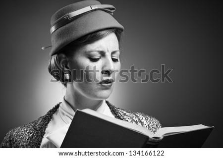 Retro woman reading a book - stock photo