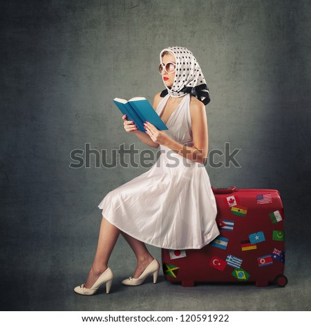 Retro woman with sunglasses and suitcase reading book portrait against vintage background. - stock photo
