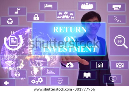 RETURN ON INVESTMENT concept  presented by  businessman touching on  virtual  screen ,image element furnished by NASA - stock photo