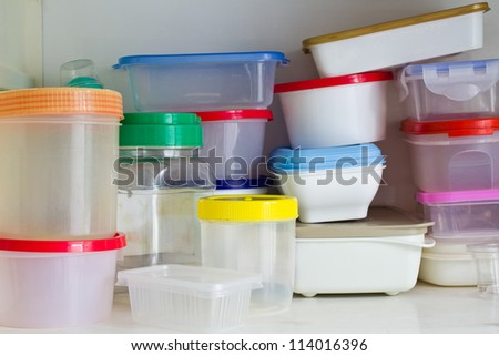 Reusable plastic container in the larder - stock photo