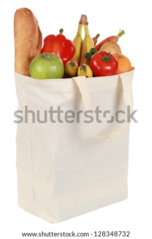 Reusable shopping bag filled with a bread, vegetables and fruits, isolated on white - stock photo