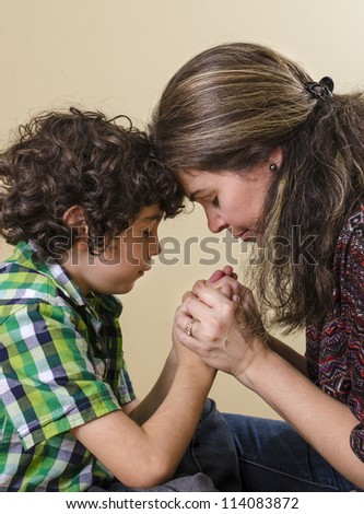 Reverence,devotion and love of a Hispanic family towards their Saviour in heaven - stock photo