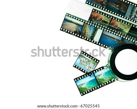 Reversal film and magnifying glass loop isolated on white background - stock photo