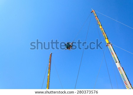 Reverse Bungee with blue sky at amusement park - stock photo