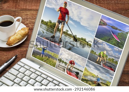 reviewing pictures of stand up paddling featuring a 60 year old  male on a laptop with a cup of coffee. All screen pictures copyright by the photographer with the same model (self). - stock photo