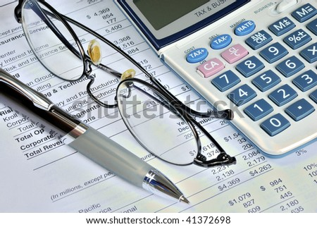Reviewing the financial report of a company - stock photo