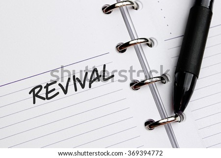 REVIVAL word written on notebook - stock photo
