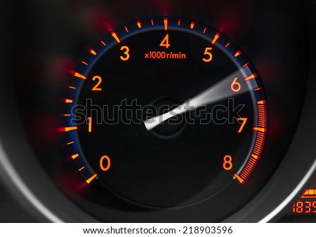 Revolution counter of a sport car showing engine revving  - stock photo