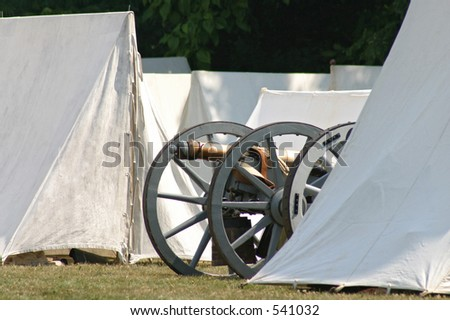 revolutionary war cannon and tents - stock photo