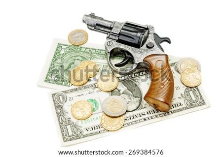 Revolver and money on white background - stock photo