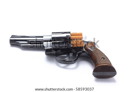 Revolver loaded with cigarettes to symbolize the dangers of smoking - stock photo