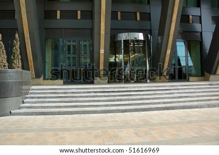revolving door of entrance of modern office building - stock photo