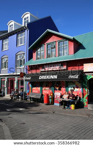 Reykjavik, Iceland - August 7, 2015: Downtown Reykjavik. Between Hallgrimskirkja and Harbor there are a lot Restaurants, Bars and Shops. A lovely place for Tourists and local people  - stock photo