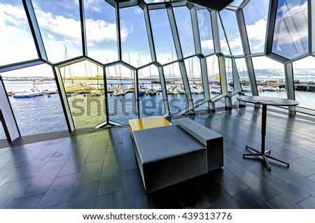 Reykjavik, Iceland - August 08, 2012: View Old harbor as seen from Harpa concert Hall interior. Harpa is a concert hall and conference center in Reykjavik opened on May 4, 2011. - stock photo