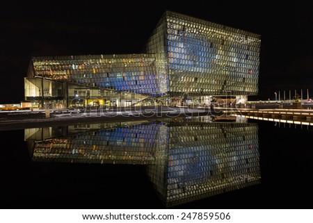 REYKJAVIK, ICELAND - January 16, 2015: Night scene of Harpa Concert Hall in Reykjavik, Iceland. It was opened on May 4, 2013.  - stock photo