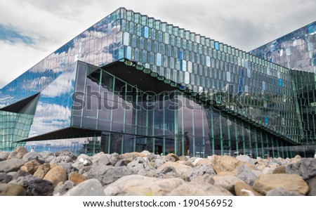 REYKJAVIK, ICELAND - June 19, 2013: Harpa Concert Hall in Reykjavik harbor, Iceland during the day, the first purpose-built concert hall in Reykjavik. It was opened on June 19, 2013 - stock photo