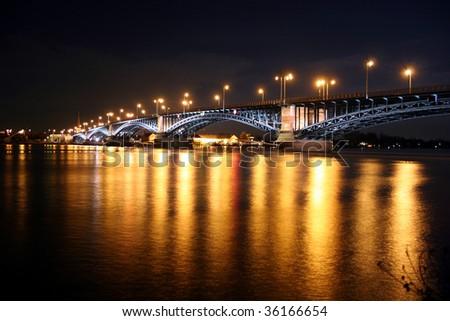 Rhine bridge Theodor-Heuss-Brücke between the german cities Mainz and Wiesbaden at night - stock photo