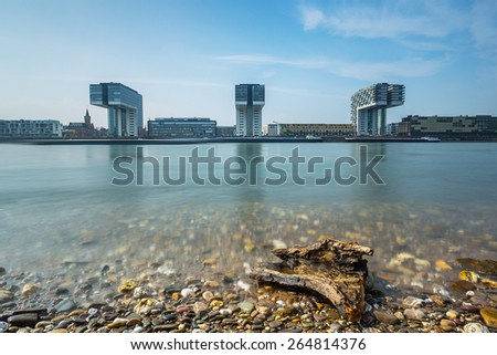 Rhine river in cologne with crane houses in summer - stock photo