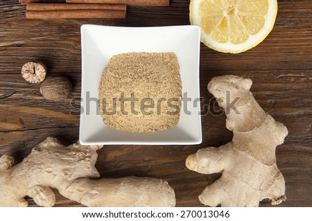 rhizome of ginger and spices on wooden table - stock photo