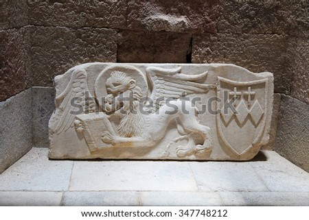 RHODES, GREECE - JUNE 12, 2015: Sculpture of a winged lion and Coat of Arms at the Archeological Museum of Rhodes, Greece. - stock photo