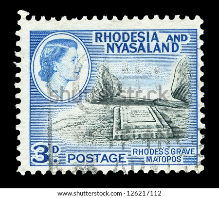 RHODESIA AND NYASALAND - CIRCA 1959: Stamp printed by the British administration showing Rhodess grave at Matopos, Bulawayo, Zimbabwe, circa 1959 - stock photo