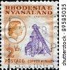 RHODESIA & NYASALAND - CIRCA 1959: A stamp printed in Rhodesia and Nyasaland shows copper mining, circa 1959 - stock photo