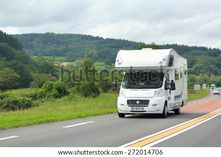 RHONE-ALPES, FRANCE - AUGUST 7, 2014: White motorhome Fiat Ducato at the interurban road. - stock photo