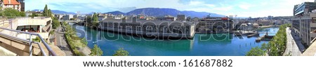 Rhone river, Batiment des Forces Motrices and fountain at Geneva, Switzerland - stock photo