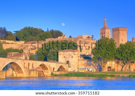 Rhone rover with medieval bridge and the Cathedral and Papal Palace (Palais des Papes) in the background, Avignon, Provence, France - stock photo