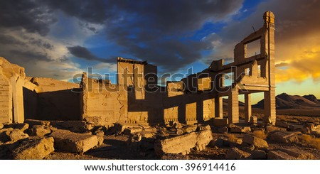 Rhyolite Nevada ghost town at sunrise with dramatic sky and shadows. - stock photo