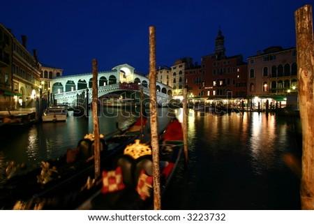 rialto bridge at night - stock photo