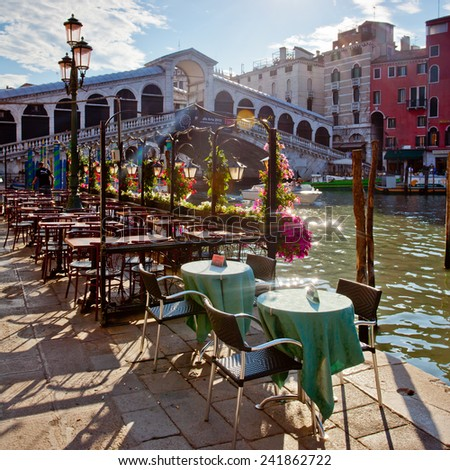 rialto bridge in Venice with terrace - stock photo