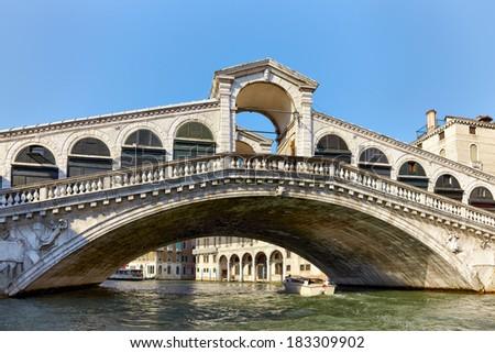 Rialto Bridge ( Ponte Rialto ) on Canal Grande in Venice, Veneto, Italy - stock photo