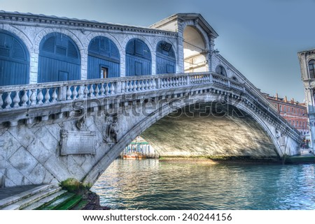 rialto bridge under a gray sky. Processed for hdr tone mapping effect. - stock photo