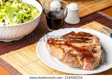 rib cooked rare on the plate - stock photo