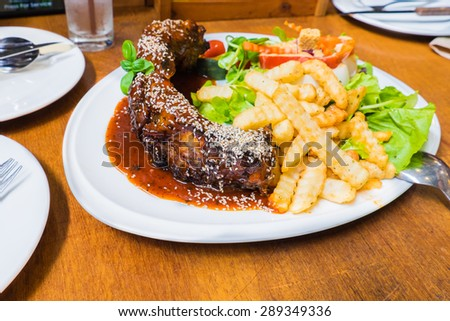 Rib steak with french fries serve on table - stock photo