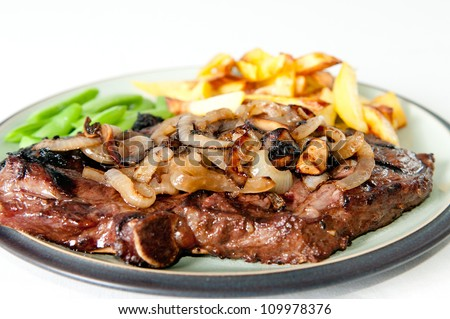 rib steak with sauteed mushrooms and onions, french fries and vegetables - stock photo