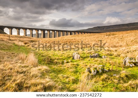 Ribblehead Railway Bridge / The Ribblehead Viaduct carries the Settle to Carlisle Railway across Batty Moss spanning 400 m and 32 m above the valley floor - stock photo