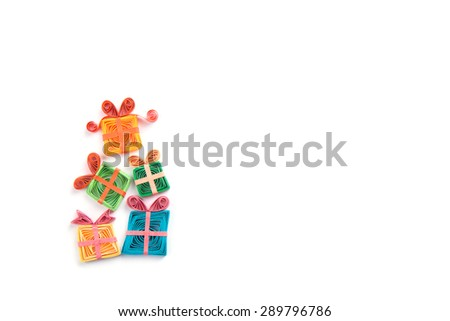 ribbon gifts quilling on a light background - stock photo