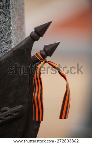 Ribbon of Saint George at the Soviet War Memorial with graves of Soviet soldiers fallen in the last days of World War II at the Olsany Cemetery in Prague, Czech Republic. - stock photo
