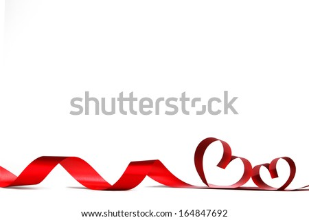 Ribbons shaped as hearts on white, valentines day concept