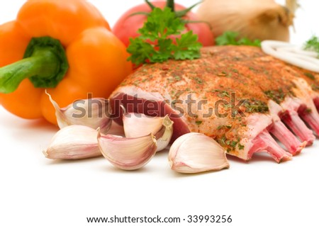 ribs and vegetables on white background - stock photo