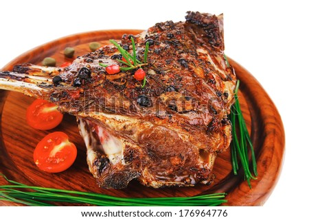 ribs on wooden plate over white background - stock photo