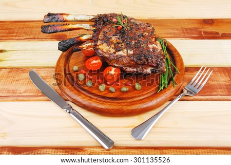 ribs rack on wood with stainless steel cutlery - stock photo