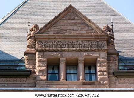 Ricardsonian Romanesque revival architecture : Queen's Park building beautiful window with lions under the roof of the Ontario Legislative Building.    - stock photo