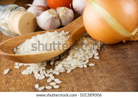 rice and healthy food isolated on wooden background texture - stock photo