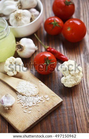 rice and vegetables on a wooden table