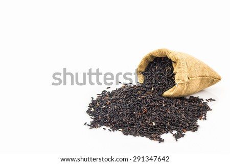 Rice berry in small burlap sack on white background.  - stock photo