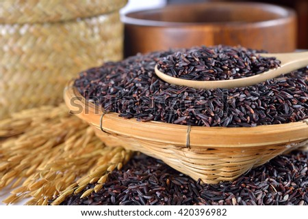 rice berry rice with wooden spoon (rice berry is crossbreed between two breed of Thailand rice, hom-nil and jasmine rice )